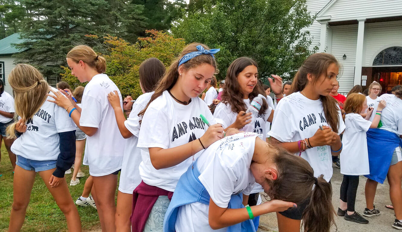 Marist campers sign each others' shirts