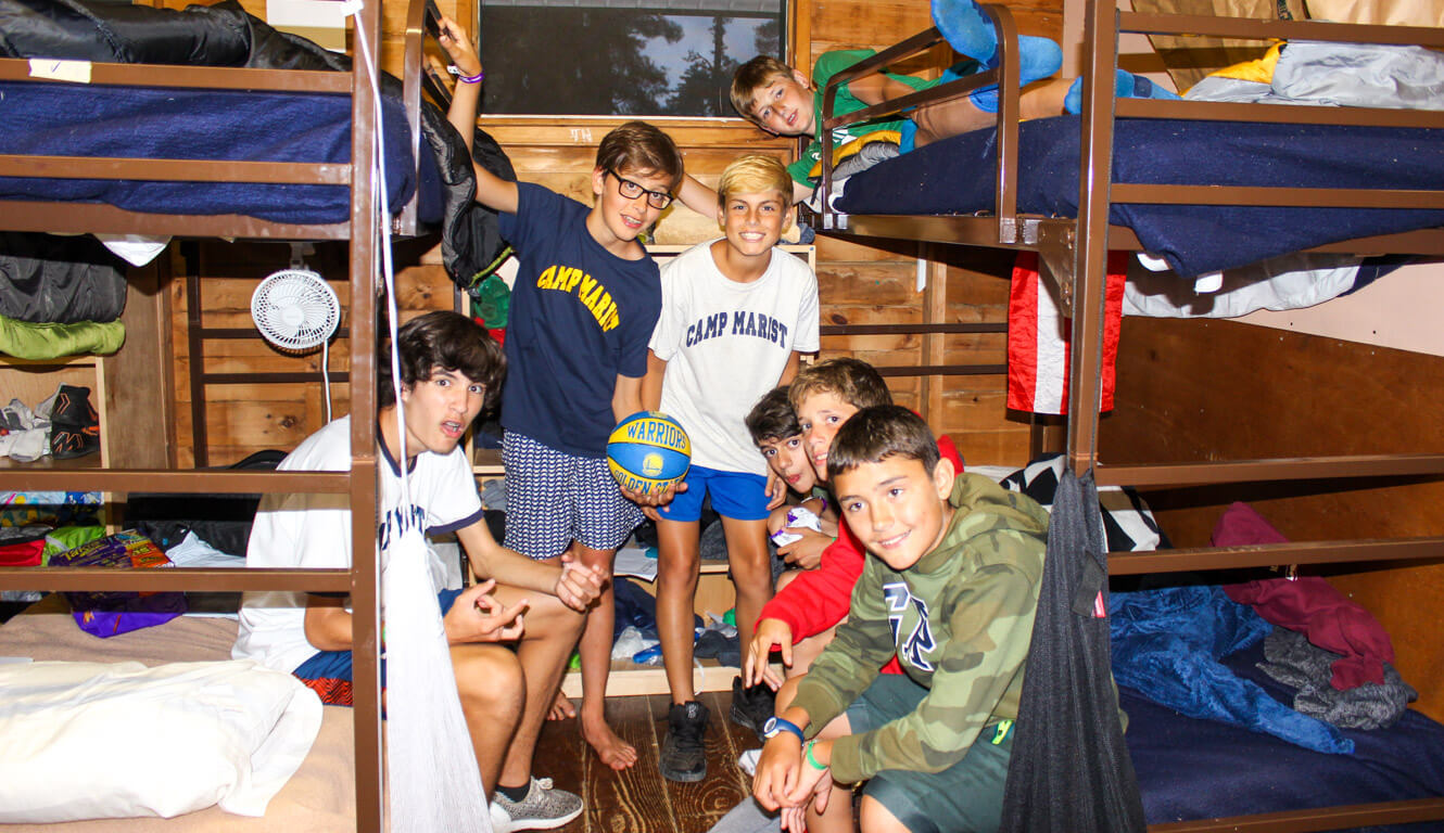 Group of boys in summer camp cabin